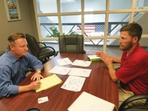 Sean Porter and Christopher Baity discussing Camp Semper K9 site plan.