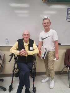 Pete, pictured here with Semper K9 volunteer AJ, in April 2017 at Benton Middle School for a history class. AJ and his family will be the K9 Coaches for Semper K9's Pete.